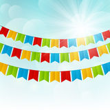 Color flags on sunny background. Color flags on blue sunny background Royalty Free Stock Photos
