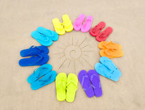 Color flip flops and drawing sun Royalty Free Stock Image