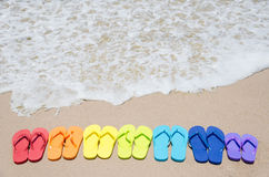 Color flip flops by the ocean Royalty Free Stock Image