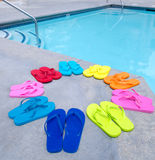 Color flip flops by the pool Stock Image