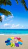 Color flip flops on sandy beach Stock Images
