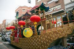 Color float and dragon in chinese new year parade stock photo
