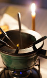 Color fondue. Photography with meat fondue dish  on a table. Very shallow depth of field Royalty Free Stock Photos