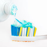 Color fresh toothpaste on a toothbrush closeup Stock Photos