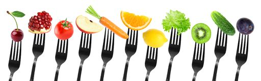 Color fruits and vegetables on fork Royalty Free Stock Photos