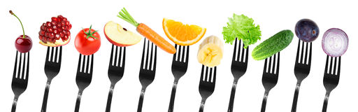 Color fruits and vegetables on fork Stock Images