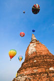 Color full balloon over the big Pagoda. Balloon show at the ancient city, Thailand Royalty Free Stock Photos