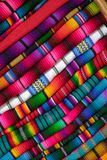 Color full fabric of mexico. A pile of color full fabric as seen on the markets of mexico ans guatemala stock photos