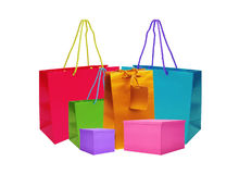 Color gift bags and boxes isolated on white Royalty Free Stock Images