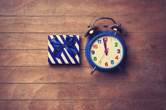 Color gift box and alarm clock Royalty Free Stock Photos