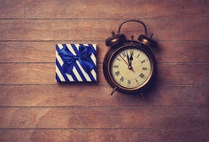 Color gift box and alarm clock Royalty Free Stock Photo