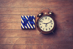 Color gift box and alarm clock Stock Photos