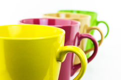 Color glass mug. On white background Stock Photography