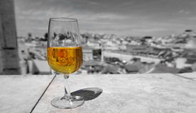 Color in the glass of porto. Art effect with yellow poro in fron of gray Lisbon Stock Images