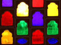 Color glass windows. Fine image detail of colorful glass of ancient windows Stock Photo