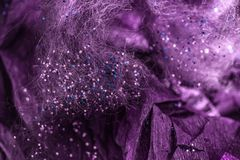 Color glitters with fibers and paper, closeup royalty free stock images