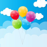 Color Glossy Balloons Against Blu Sky Background Stock Photo