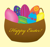 Color glossy Easter eggs in a basket Stock Image