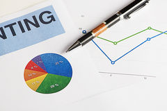 Color graphics and business economics with a pen Stock Photo