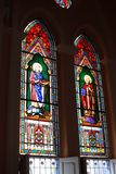 The color grass window in image of St. Ludovicus Rex (left) and St. Augustine Royalty Free Stock Photography