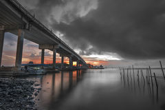Color and gray at sunrise. Under bridge Stock Photos
