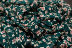 Color green textil, silk fabric with pleats Stock Photos