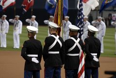 Color Guard. Four members of a United States Marine Corps Color Guard during a baseball game royalty free stock photo