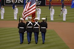 Color Guard. Four members of a United States Marine Corps Color Guard during a baseball game stock photography