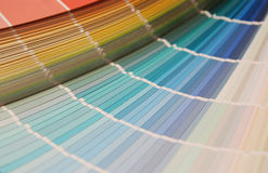 Color guide. Stock photo of a Paint swatches fanned out to reveal various colours color guide royalty free stock photo