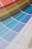 Color guide. Stock photo of a Paint swatches fanned out to reveal various colours color guide royalty free stock photos