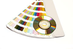 Color guide and CD. Over white backgound stock photography