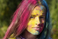 Color hair. Girls with colorful hair and face enjoing in the moment. Colorful holi on painted hair and face. Happy life royalty free stock images