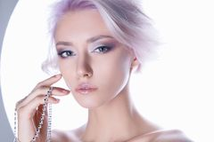 Color hair young woman with jewelry. Sensual blond girl with haistyle and make-up isolate fashion portrait stock images
