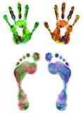 Color hand and foot prints isolated on white Royalty Free Stock Photos