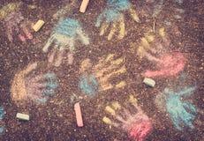 Color hand prints on pavement Stock Image