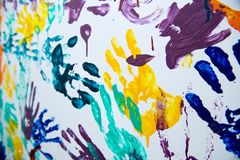 Color handprints on the wall