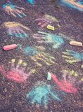 Color hands prints on pavement Stock Image