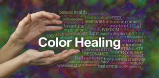 Color Healing Therapy Website Banner. Female hands sensing the words COLOR HEALING surrounded by a relevant word cloud on a multicolored background royalty free stock photography