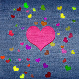 Color hearts on jeans Stock Photos