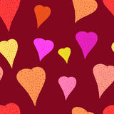 Color hearts pattern. Romantic seamless pattern with hand drawn hearts on dark background Royalty Free Stock Images