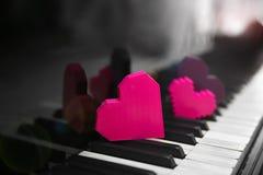 Color hearts on piano keys. Close up Stock Photo