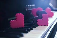 Color hearts on piano keys. Close up Royalty Free Stock Photos