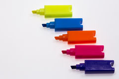 Color Highlight Pens. Yellow pink orange blue, on white background royalty free stock image