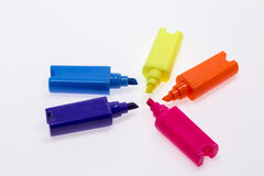 Color Highlight Pens. Yellow pink orange blue, on white background royalty free stock photography