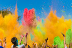 Color holi festival. Crowd of people throwing colored paint on Holi festival Stock Photography