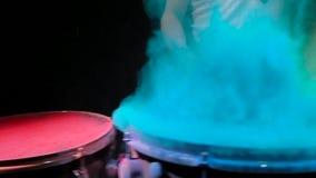 Color holi powder drum , slow motion. black background.