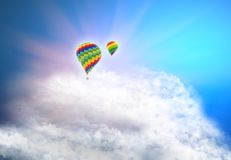 Color hot air balloon in blue sky with clouds and sun rays. 3d illustration.  Stock Photos
