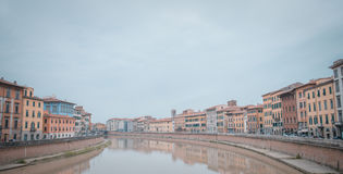 Color houses of Pisa and Arno River Stock Image