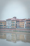Color houses of Pisa and Arno River Stock Photography