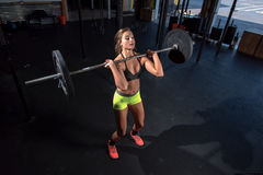 Color  image of an athletic woman in a gym working out Stock Photos